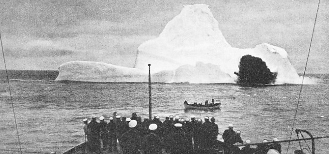 The crew of an Ice Patrol cutter watches the effect of high explosives on a floating mountain of ice