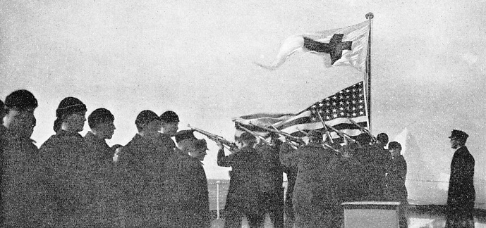 Members of the crew of an International Ice Patrol coast-guard cutter firing a salute in memory of the 1,498 lives lost in the Titanic disaster