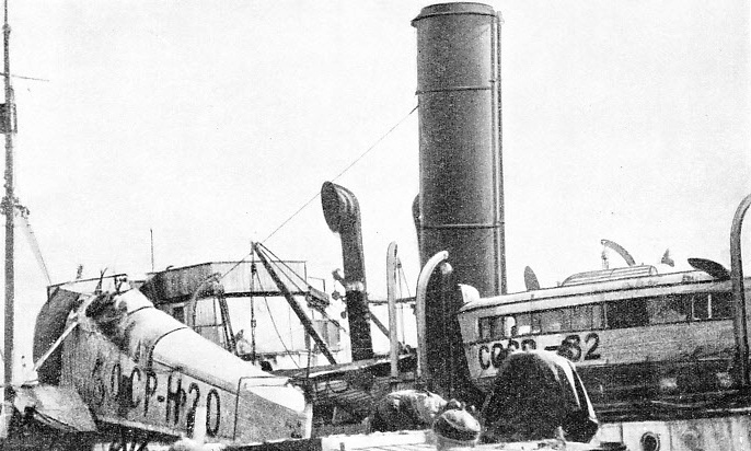 UNLOADING THE SEAPLANE FROM THE CHELYUSKIN