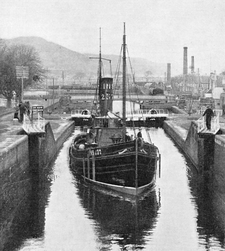 AN INVERNESS DRIFTER, the Invernairne, passing through the locks at Inverness