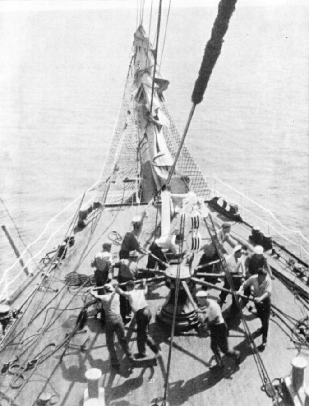 HEAVING THE CAPSTAN ROUND. The illustration shows the crew of the Penang raising the ship's anchor by means of the capstan