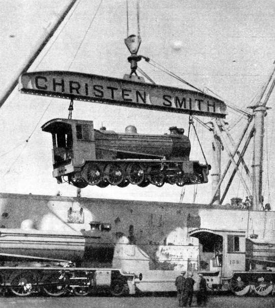 The ship Belpareil lifting a complete locomotive on board
