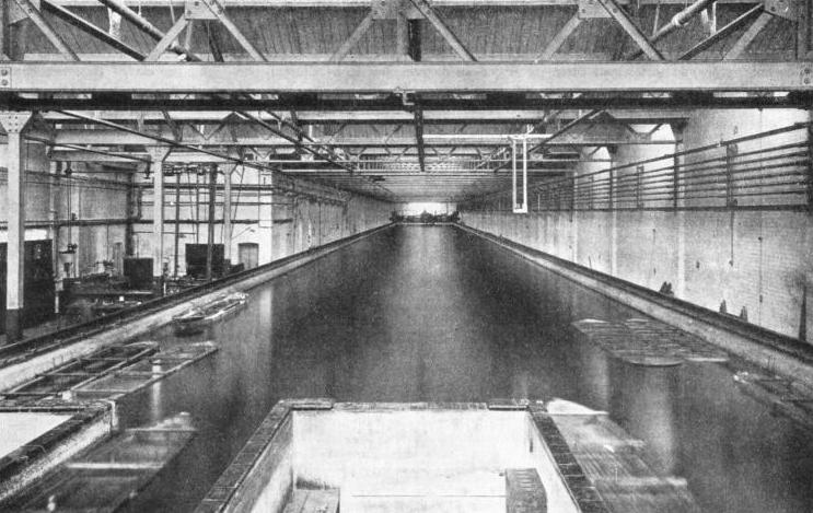 A MILLION AND A QUARTER GALLONS of water are contained in the Alfred Yarrow Testing Tank at Teddington, Middlesex