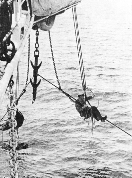 SECURING THE CABLE which the specially-designed grapnel has raised from the sea-bed
