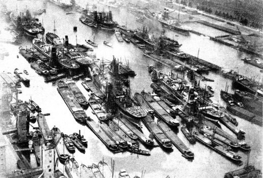 A photograph of Rotterdam showing many of the Rhine barges