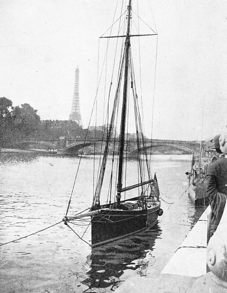A picturesque view of the yacht Firecrest moored on the River Seine