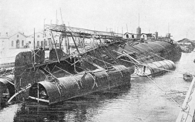 A remarkable picture of the inverted battleship Leonardo da Vinci safely brought to dock in September, 1919